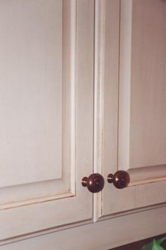 Faux painted antiqued cabinet doors close up