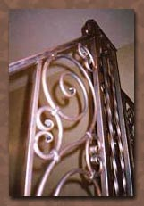 Faux painting bronze metal patina on wrought iron railing