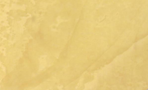 Close-up of a Venetian Plaster faux finish in a Behr color called Tuscan Sun.
