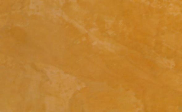 Close-up of a Venetian Plaster faux finish in a Behr color called Pompeii.